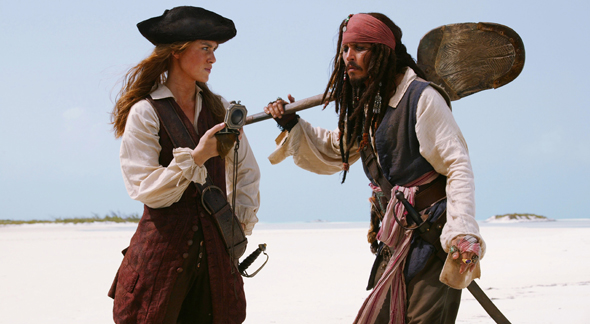 Pictured: Elizabeth Swan (KEIRA KNIGHTLEY) and Captain Jack Sparrow (JOHNNY DEPP) in a scene from PIRATES OF THE CARIBBEAN: DEAD MAN'S CHEST. Johnny Depp, Orlando Bloom and Keira Knightley reunite in Walt Disney Pictures', in association with Jerry Bruckheimer Films, PIRATES OF THE CARIBBEAN: DEAD MAN'S CHEST, an all new epic tale chronicling the further mis-adventures of Captain Jack Sparrow. Produced by Jerry Bruckheimer and directed by Gore Verbinski from a screenplay written by Ted Elliott & Terry Rossio, Captain Jack sets sail on an all new adventure - filled with more intrigue, more spectacular special effects and more comedy - 2006. APPROVED FOR PRINT USE ONLY - MAGAZINES & NEWSPAPERS. NOT APPROVED FOR INTERNET USE.
