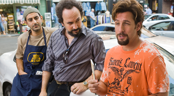 In Columbia Pictures' You Don't Mess with the Zohan, Zohan (Adam Sandler, right) falls in with a group of Israeli immigrants to New York, including Yhitzak (Ben Wise, left) and Yosi (Robert Smigel, center). The film is directed by Dennis Dugan, written by Adam Sandler & Robert Smigel & Judd Apatow, and produced by Adam Sandler and Jack Giarraputo. The release date is June 6, 2008.