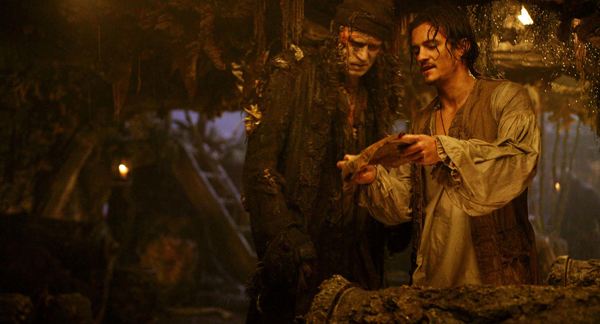 Pictured: Bootstrap Bill (STELLAN SKARSGÅRD) and Will Turner (ORLANDO BLOOM) in a scene from PIRATES OF THE CARIBBEAN: DEAD MAN'S CHEST. Johnny Depp, Orlando Bloom and Keira Knightley reunite in Walt Disney Pictures', in association with Jerry Bruckheimer Films, PIRATES OF THE CARIBBEAN: DEAD MAN'S CHEST, an all new epic tale chronicling the further mis-adventures of Captain Jack Sparrow. Produced by Jerry Bruckheimer and directed by Gore Verbinski from a screenplay written by Ted Elliott & Terry Rossio, Captain Jack sets sail on an all new adventure - filled with more intrigue, more spectacular special effects and more comedy - 2006.